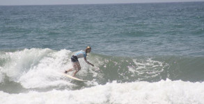 Michelle Waltman surfing at 18th Ave on Pensacola Beach, FL