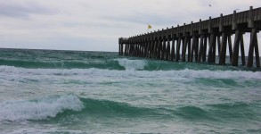 East side of Pensacola Beach Gulf Pier with waves to surf on.