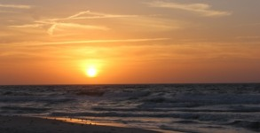 New Year's Day Sunrise with the full sun and waves to surf at Pensacola Beach