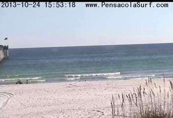 Afternoon surf report of Pensacola Beach with little ankle high waves and clear water with no surf.