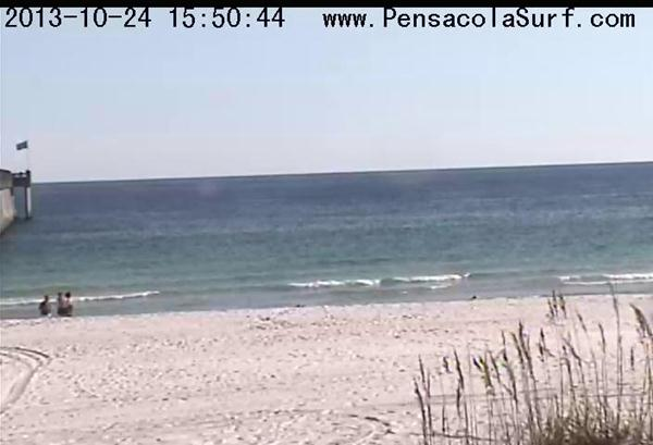Afternoon surf report of Pensacola Beach with little ankle high waves and clear water with no surf